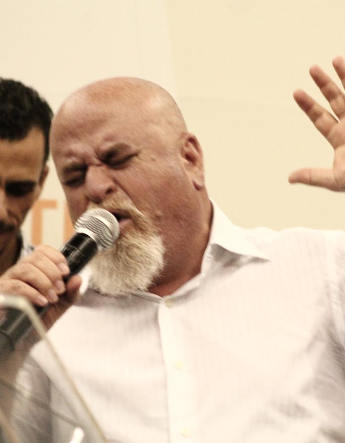 Pastor Afeef halasah preaches at the conference awake church.