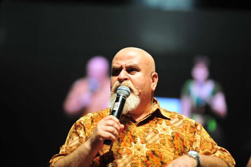 Afeef Halasah preaching at a Malaysian convention centre.